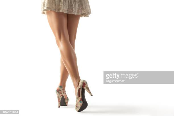 Women legs moving on white background