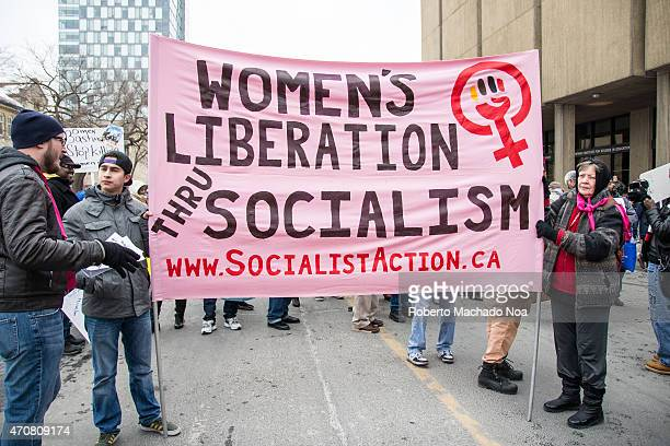 Women liberation through Socialism sign during protest march the International Women day in Toronto Thousands gathered in Toronto on Saturday day to...