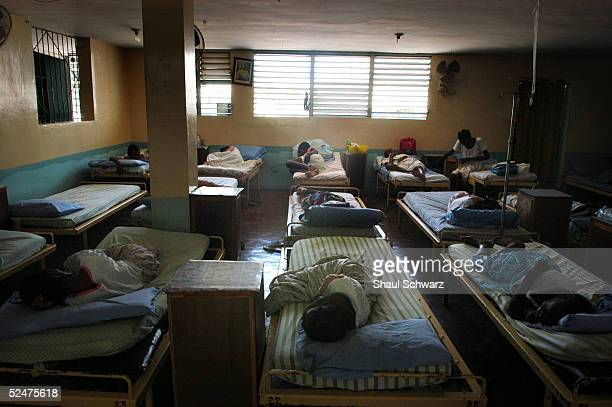 Women lie in bed March 22 2005 at the Sisters Missionary of Charity Hospital in PortauPrince Haiti Over eighty per cent of the women in this hospital...