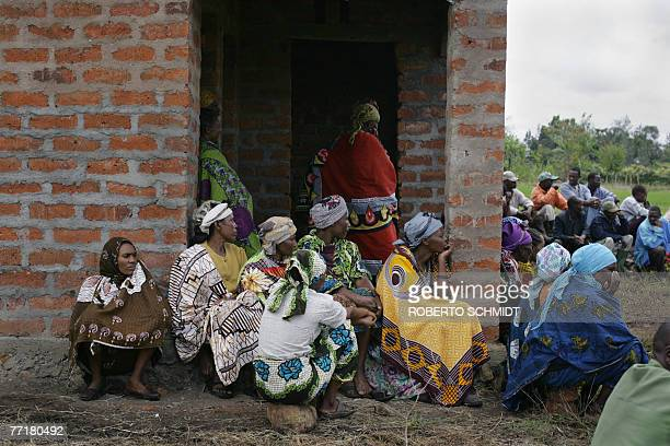 Women living in the Usa River village near Arusha Tanzania sit patiently as they wait for the arrival to their gathering of Princess Astrid of...