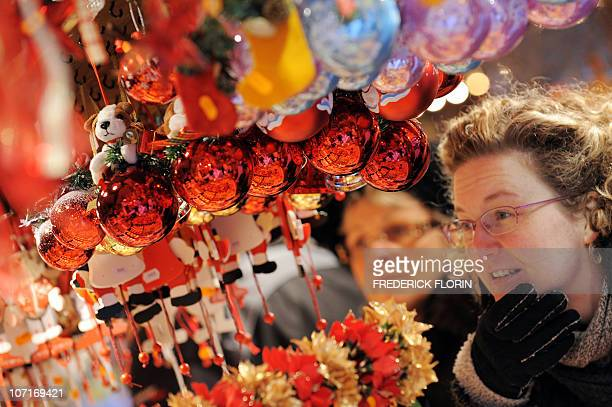 Women look at Christmas decorations on November 27 2010 during the opening of the Strasbourg Christmas market which is the largest and one of the...
