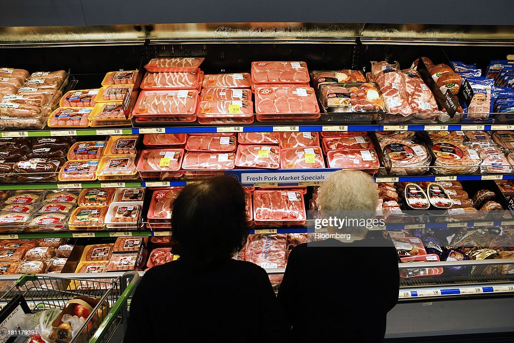 Women look at fresh pork for sale during the grand opening of a Wal-Mart Stores Inc. location in the Chinatown neighborhood of Los Angeles, California, U.S., on Thursday, Sept. 19, 2013. Wal-Mart Stores Inc. will phase out 10 chemicals it sells in favor of safer alternatives and disclose the chemicals contained in four product categories, the company announced Sept. 12. Photographer: Patrick T. Fallon/Bloomberg via Getty Images