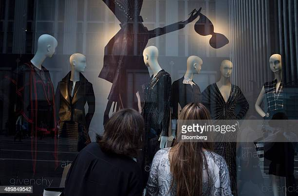 Women look at mannequins displayed in the window of a store on Fifth Avenue in New York US on Saturday Sept 21 2015 Consumer confidence rebounded...
