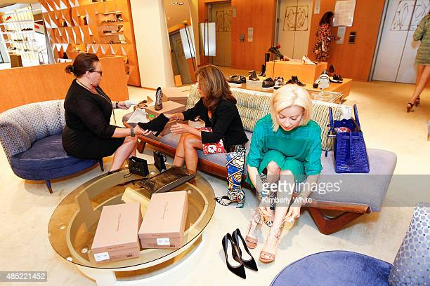 Women look at shoes by Gianvito Rossi at Barneys New York hosts an afternoon of shopping with designer Gianvito Rossion August 25 2015 in San...