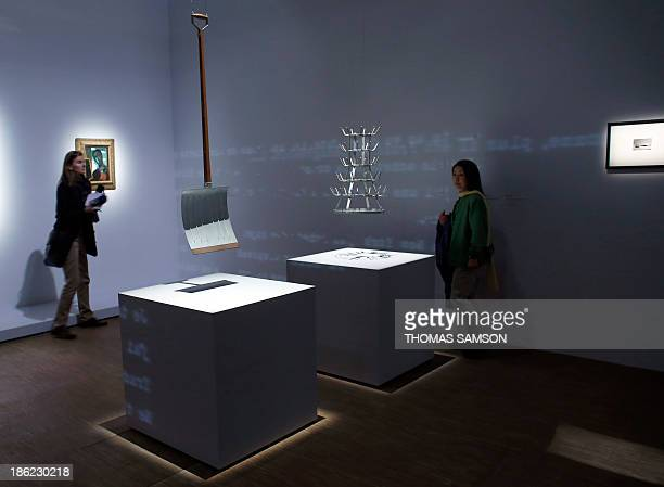 Women look at works of art by French artist Marcel Duchamp In advance of the broken arm and PorteBouteilles displayed during the exhibition Le...