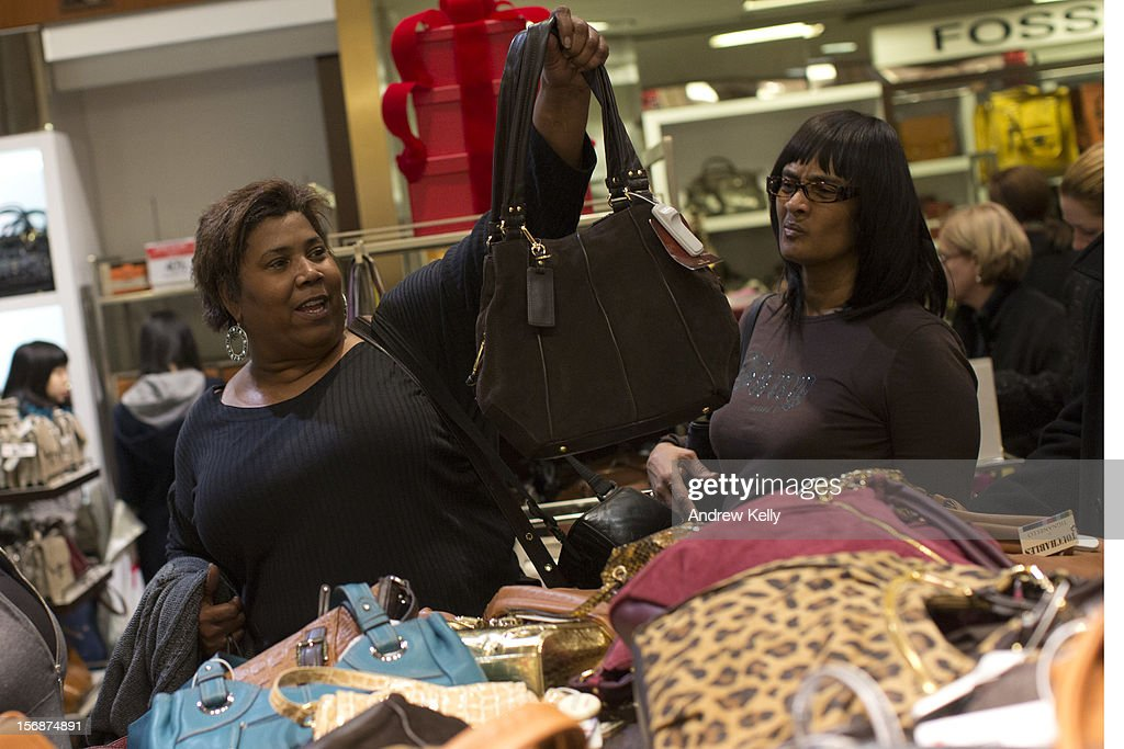 Women look for handbags in Macy's during the Black Friday sales on November 23, 2012 in New York City. Shoppers filled stores in search of the many potential bargains on offer during the traditional yearly sale, which got its name as it's said to put retailers 'in the black,' or making a profit.
