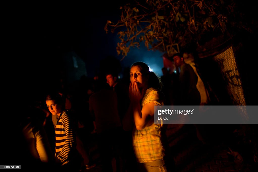 Women look on as antigovernment protesters in the suburb of Sultan Gazi clash with police forces at night in Istanbul Turkey on June 9 2013 The...