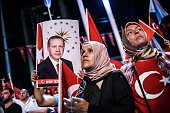 Women look on during a ProErdogan rally in Taksim square in Istanbul on July 22 following the failed military coup attempt of July 15 Turkey detained...