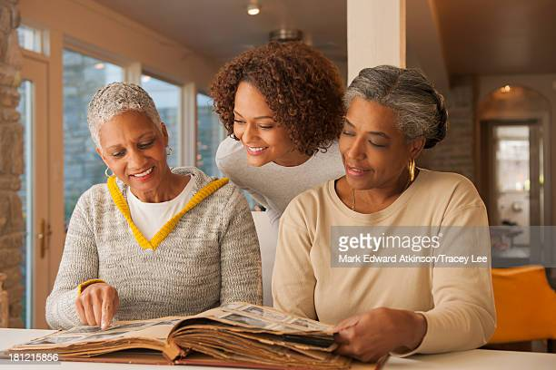 Women looking at family photo album