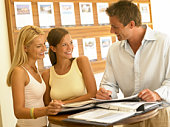 Women looking at homes for sale