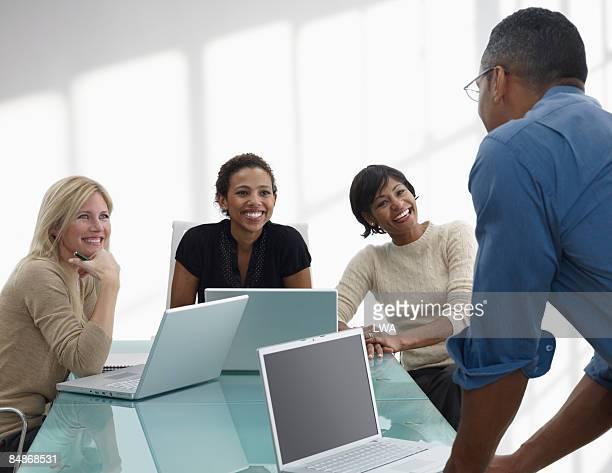 Women Looking at Man During Business Meeting