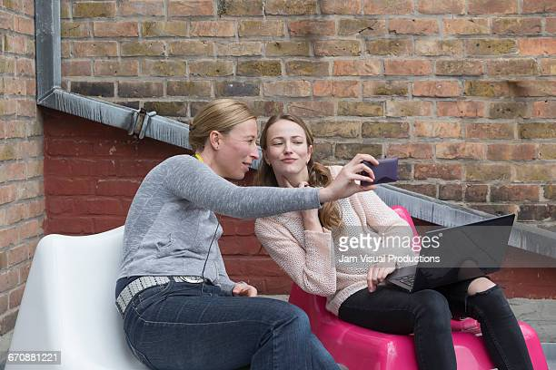Women looking at smart phone