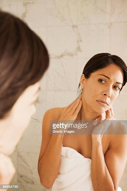 Women looking into mirror