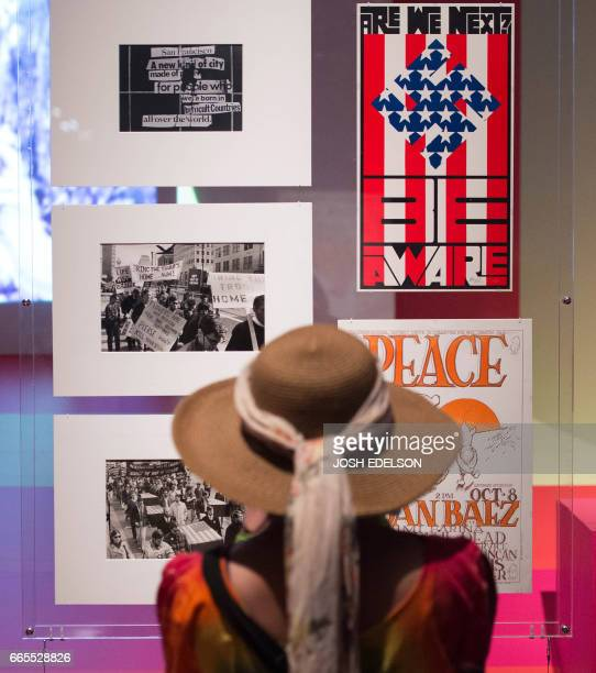 A women looks at art pieces at The Summer of Love Experience Art Fashion and Rock Roll an art exhibit at the deYoung museum in San Francisco...