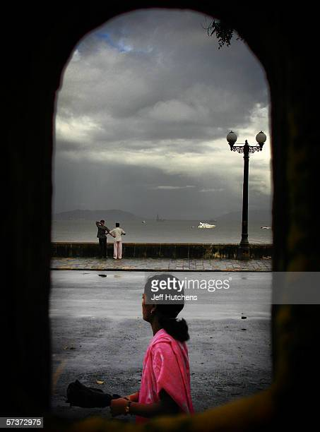 A women looks down the road on September 09 2005 in Mumbai India Emerging from one of the most deadly monsoon seasons in recent history daily life...