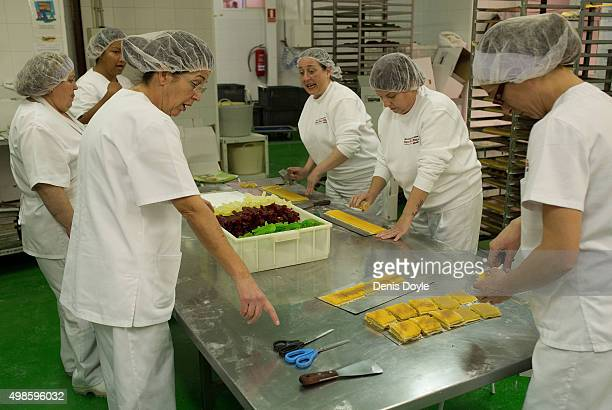 Women make 'Pan de Cadiz' a variety of turron mixed with dried fruits at the Turrones Primitivo Rovira factory on November 24 2015 in Jijona Spain...