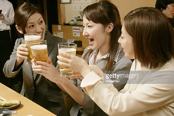 Women making a toast in the Japanese-style pub