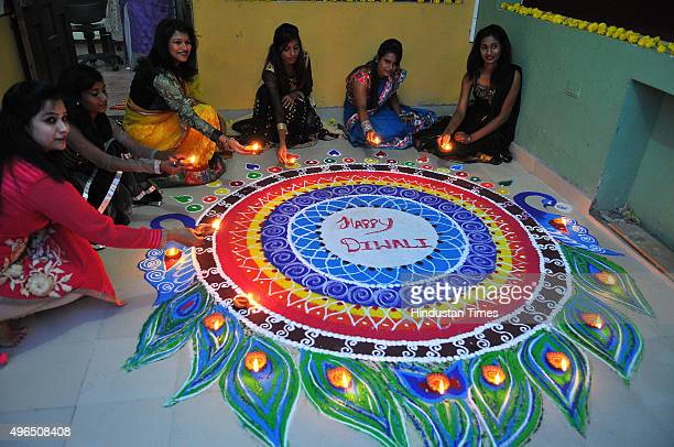 Women making grand rangoli and enjoying Diwali festivities on November 10 2015 in Indore India Festival of light Diwali is one of the most important...