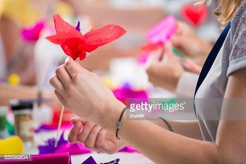 Women making paper flowers : Stock Photo
