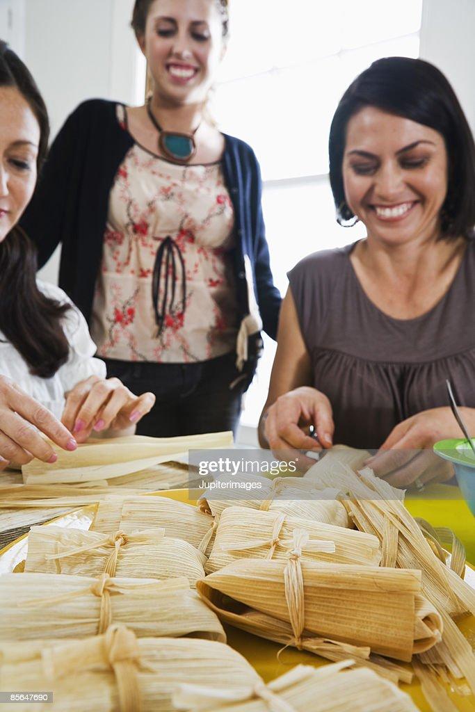 Women making tamales : Stock Photo