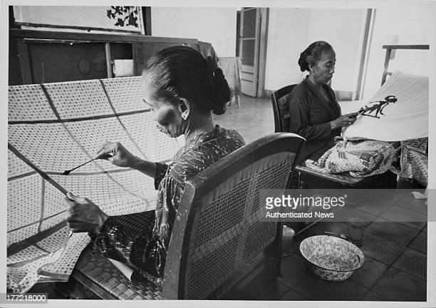 Women making traditional batik cloth Yogyakarta Indonesia circa 19601985