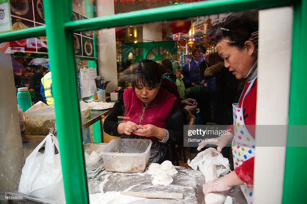 Women making traditional Chinese food in a cafe on February 10, 2013 in London, England. London's Chinese community celebrate the start of the Year of The Snake with traditional dancing, music and fireworks.