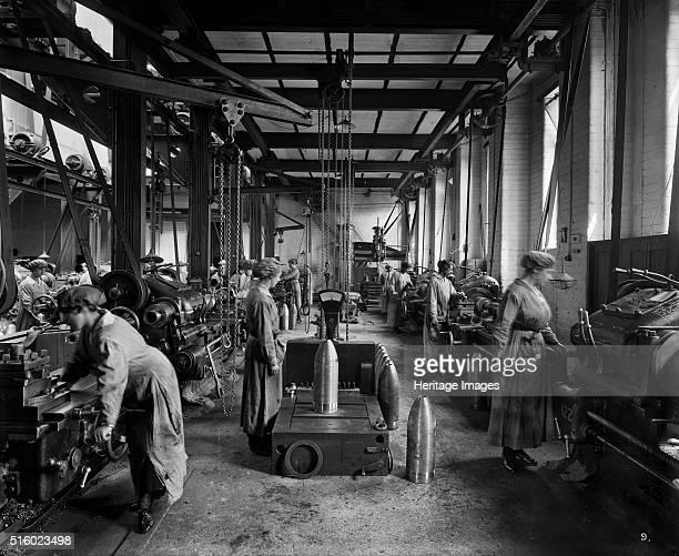 Women manufacturing shell casings Cunard Shell Works Bootle Merseyside 1917 Artist H Bedford Lemere