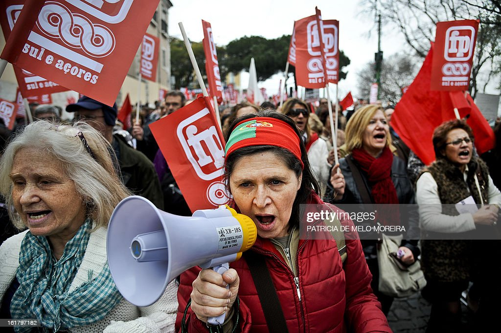 Women march and hold flags during a demonstration organized by Portugal's biggest trade union CGTP (Portuguese General Workers Confederation) against government austerity measures in Lisbon, on February 16, 2013.