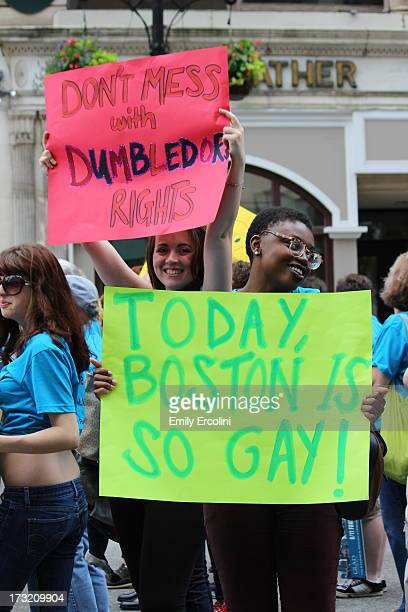 CONTENT] Women march in the Boston Pride Parade holding signs and cheering in early June of 2013 The signs read 'Today Boston is so gay' and 'Don't...