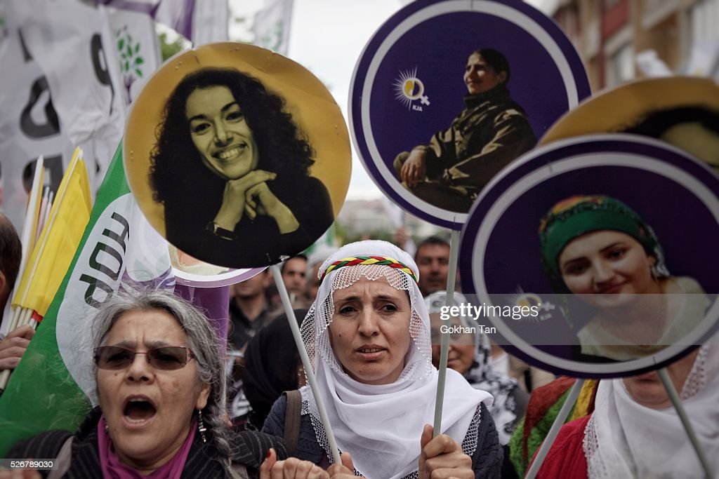 Women march with banners in Istanbul's Bakirkoy district to celebrate May Day on May 1, 2016 in Istanbul, Turkey. Turkish police used tear gas and water cannon to disperse protesters as they tried to make their way to Taksim Square and other protest points.