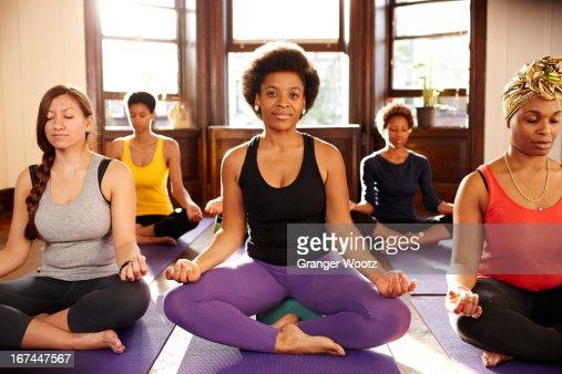 Women meditating in yoga class : Stock Photo