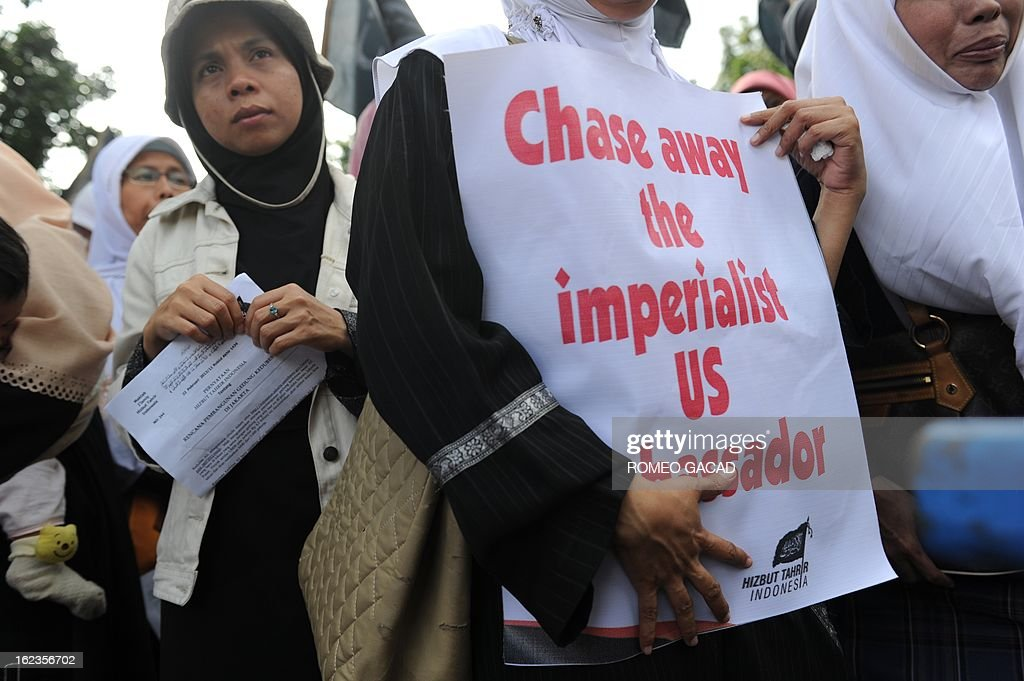 Women members of the hard-line Islamic group Hizbut Tahrir Indonesia stage a demonstration outside Jakarta Governor's office to protest the planned expansion of the US Embassy in Jakarta on February 22, 2013.
