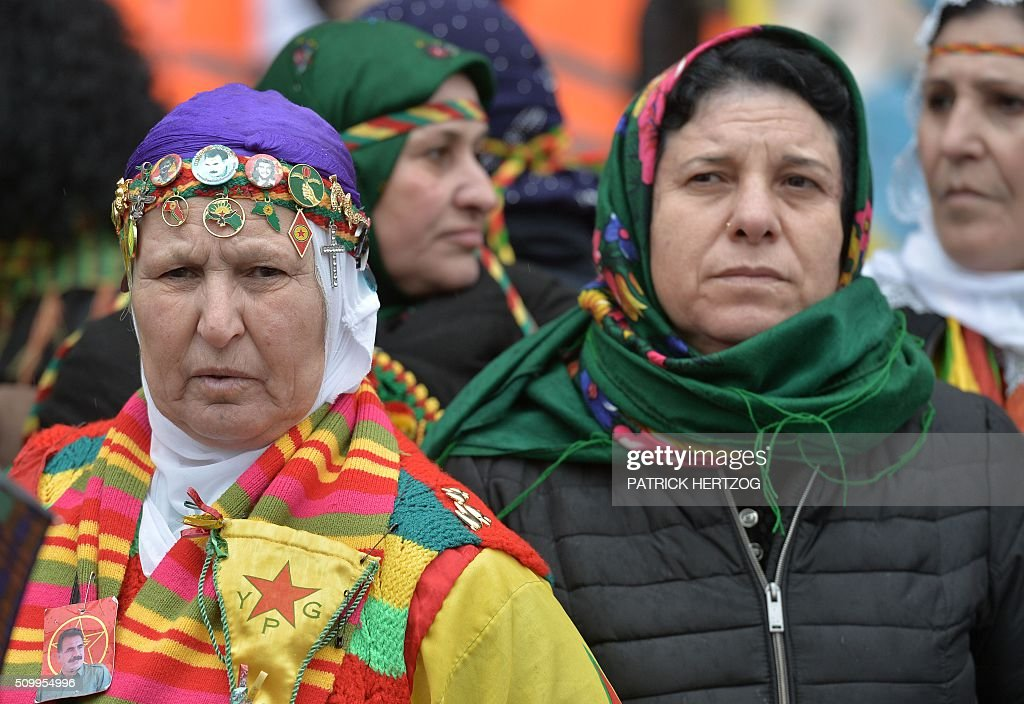 Women members of the Kurdish community take part in the annual rally of Kurds from all over Europe to denounce the detention of jailed leader of Turkey's Kurd rebels, Abdullah Ocalan, on February 13, 2016, in Strasbourg, eastern France, Ocalan was captured by Turkish undercover agents in Kenya in 1999, brought back to Turkey and sentenced to death. His sentence was later commuted to life. / AFP / PATRICK HERTZOG