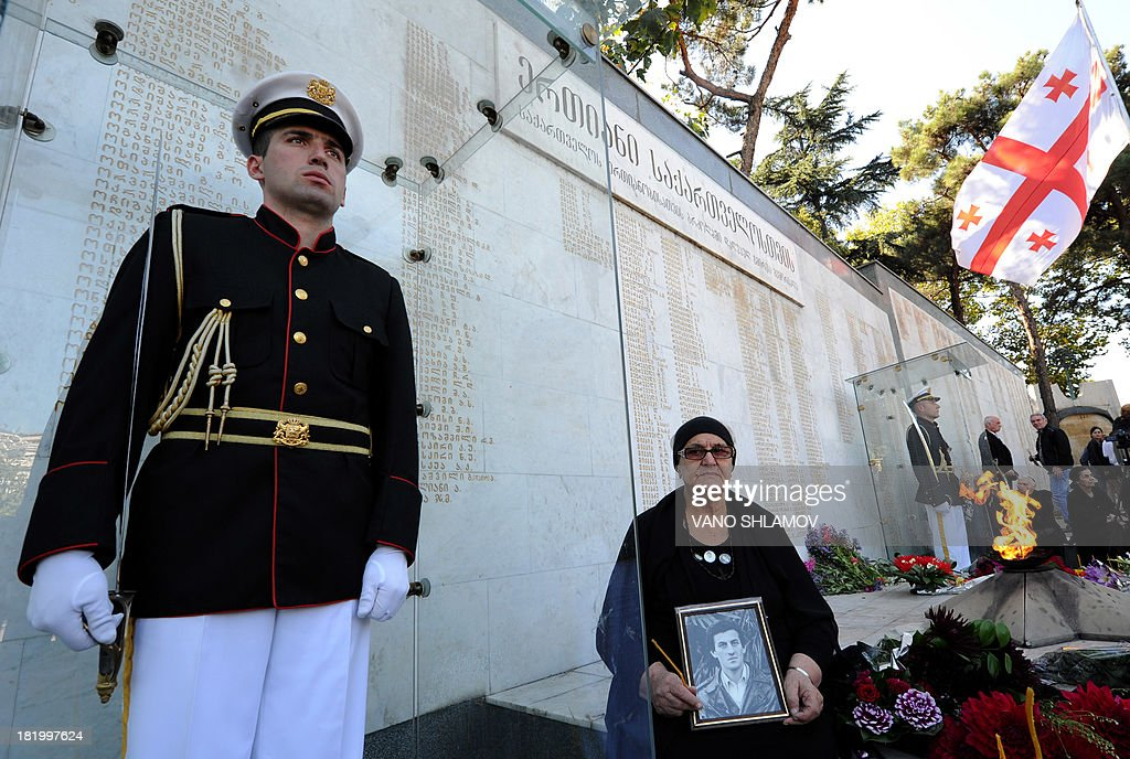 Women mourn at a memorial to Georgians killed during the 1992-1993 armed conflict in Abkhazia during a ceremony to mark the annual anniversary of the event in Tbilisi, on September 27, 2013. Abkhazian separatists waged a war with Georgia in the 1990s after the break-up of the Soviet Union that killed several thousand people and left 250,000, mostly ethnic Georgians, as refugees. Georgia insists that Abkhazia is an integral part of its territory but Russia has recognised it and South Ossetia as independent states following its brief conflict with Georgia in 2008.
