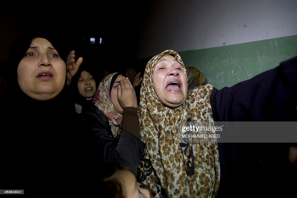 Women mourn during the funeral of Bilal Samir Oweida, a 20-year-old Palestinian, on January 24, 2014 in Beit Lahia, northern Gaza Strip. Bilal Samir Oweida was 'shot in the chest by Israeli soldiers' east of Jabaliya said Ashraf al-Qudra, a spokesman for the Hamas-run health ministry as Israeli forces said he had entered 'a prohibited area'.