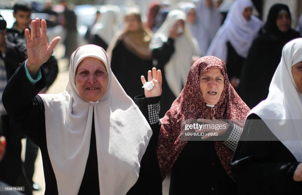 Women mourn during the funeral of Hamas militant and lawmaker Mariam Farahat at al-Omari Mosque in Gaza City on March 17, 2013. Farhat, who was known for losing three of her militant sons to suicide bombings and Israeli military attacks, died after a long-term illness.