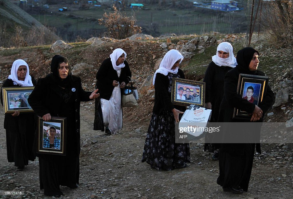 Women mourn for the victims of a Turkish air raid, at the cemetery of Gulyazi Village on December 28, 2012 on the first anniversary of a Turkish military air strike aimed at Kurdish rebels that killed 34 civilians working as smugglers at the Turkey-Iraq border in Sirnak. AFP PHOTO/STR