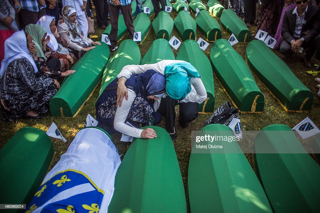 Women mourn over the coffin before the mass funeral for 136 newly-identified victims of the 1995 Srebrenica massacre attended by tens of thousands of mourners during the 20th anniversary of the massacre at the Potocari cemetery and memorial on July 11, 2015 in Srebrenica, Bosnia and Herzegovina. At least 8,300 Bosnian Muslim men and boys who had sought safe heaven at the U.N.-protected enclave at Srebrenica were killed by members of the Republic of Serbia (Republika Srpska) army under the leadership of General Ratko Mladic, who is currently facing charges of war crimes at The Hague, during the Bosnian war in 1995.