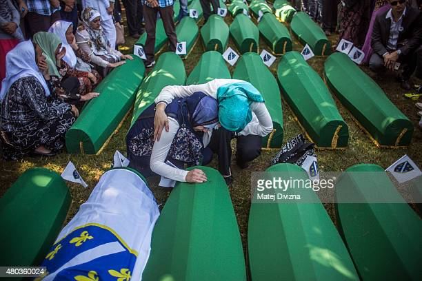 Women mourn over the coffin before the mass funeral for 136 newlyidentified victims of the 1995 Srebrenica massacre attended by tens of thousands of...