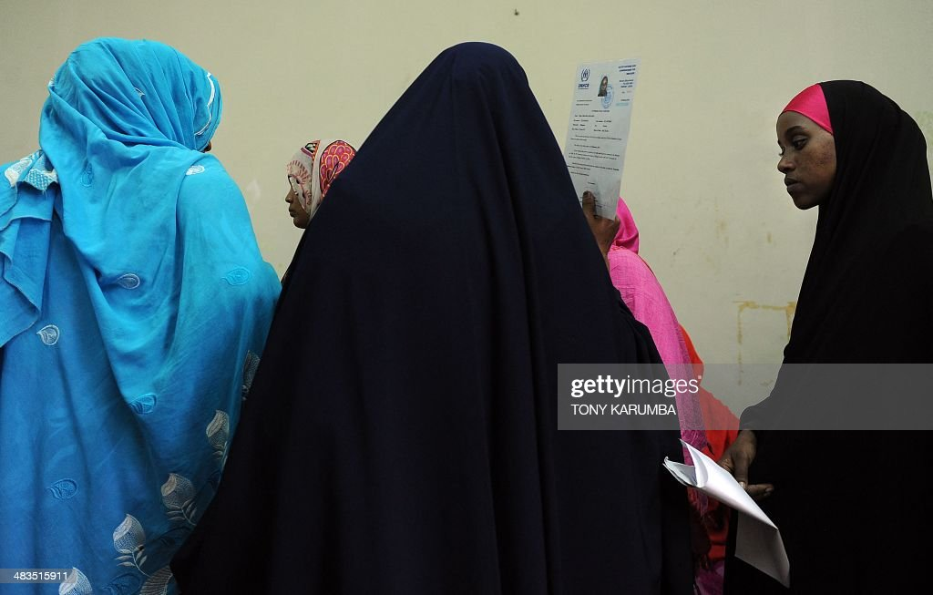 Women of Somali ethinicity wait with their identification documents to be verified by government officers at a temporary vetting centre in Nairobi on April 9, 2014. Dozens of Somalis have been expelled from Kenya, officials said on April 9, as security forces maintained a major crackdown on suspected Islamists that has seen thousands rounded up in the country. Kenya's Interior Minister Joseph Ole Lenku said 3,000 people have so far been detained in the operation, and 82 of them flown back to Somalia's Mogadishu. He said hundreds more were still undergoing identity checks.