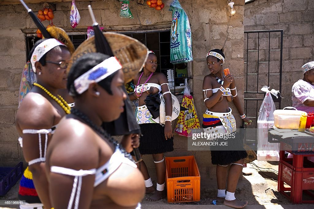 Women of the Nazareth Baptist Church (alternatively called 'The Nazarite Church', 'iBandla lamaNazaretha', or the 'Shembe Church') cool off with a drink during a pilgrimage to a holy hill on January 26, 2014, in Durban.