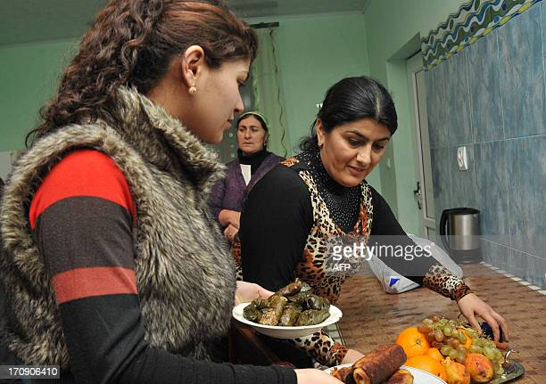Women of Yezidi community put the dinner on at their home in the Armenian village of Zovuny some15 km outside Yerevan on May 1 2013 The Yezidi are...