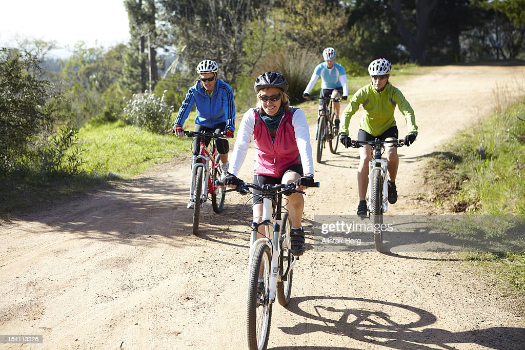 Women on a bike ride in the countryside : Stock Photo