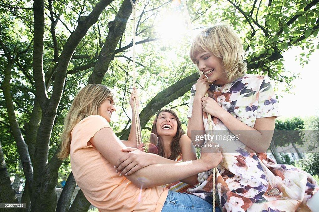 Women on a Swing : Stock Photo