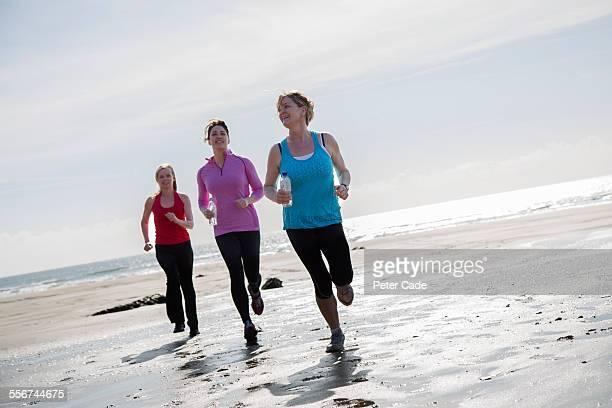 women on beach , running , sports