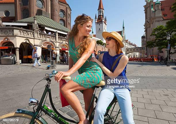 Women on bicycle in Munich Viktualienmarkt, Munich, Germany