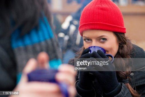Women on Christmas market drinking punch : Stock Photo