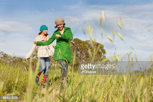 Women on meadow. : Stock Photo