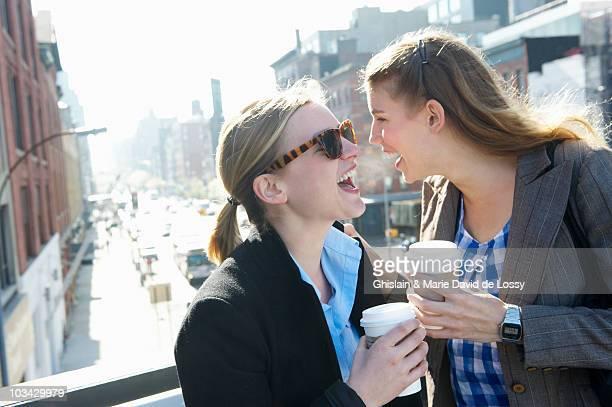 Women on their coffee break, smiling