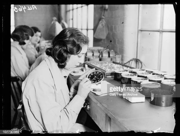 Women painting alarm clock faces Ingersoll factory January 1932 Photograph by Cardew of women using luminous paint at the Ingersoll Watch and Clock...